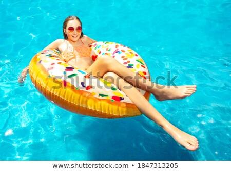 Tienermeisje zonnebril zwembad matras recreatie zomer Stockfoto © dolgachov