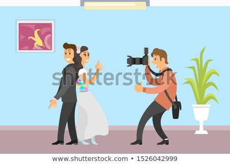 Groom in Suit and Bride Wearing Gown, Fun Spy Pose Stock photo © robuart