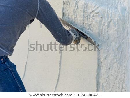 trabajador · mojado · piscina · yeso · edificio · construcción - foto stock © feverpitch