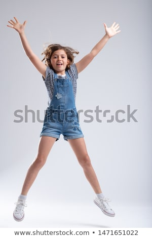 Athletic slender young girl jumping in the air Stock photo © Giulio_Fornasar