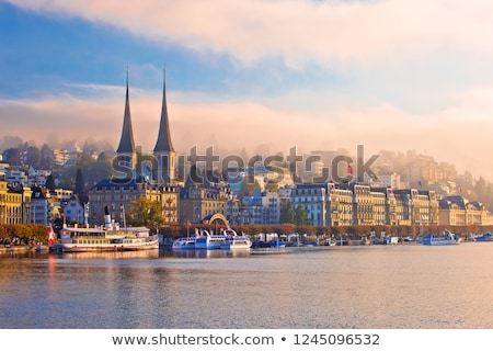 Town of Lucerne mystic morning fog view from lake Stock photo © xbrchx