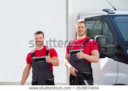 Сток-фото: Male Janitors Showing Thumbs Up Sign At Outdoors