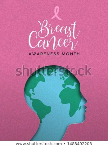 Stock photo: Breast Cancer awareness pink papercut world map