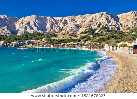 baska idyllic pebble beach with high waves in town of baska is stock photo © xbrchx