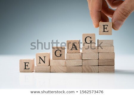 person arranging wooden blocks showing engage text stock photo © andreypopov