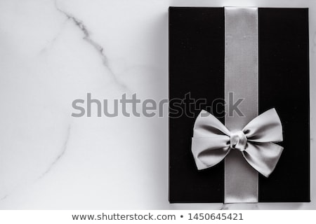 Black silk ribbon and bow on marble background, flatlay Stock photo © Anneleven