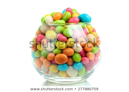 close up of glass jar with colorful candy drops Stock photo © dolgachov