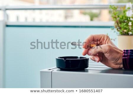 Férfi pizsama dohányzás erkély közelkép fiatal Stock fotó © nito