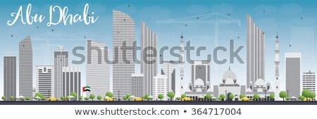 Abu Dhabi City Skyline with Gray Buildings and Blue Sky.  Stock photo © ShustrikS