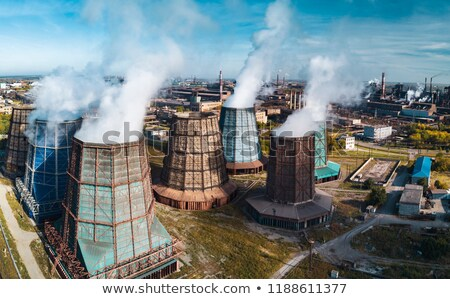 Territory of power plant with atmosphere industrial emission wastes in Budapest, Hungary. Stock photo © artjazz