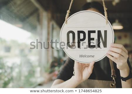 Boldog női bolt tulajdonos nyitva tábla ablak Stock fotó © feverpitch