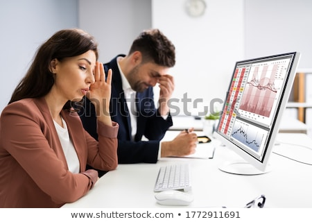 Businessman Looking At Audit Data And Financial Loss Stock photo © AndreyPopov