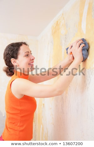 young woman by rag removes  old  wallpapers Stock photo © Paha_L