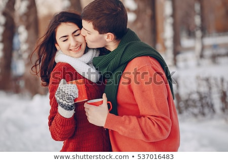 Portrait of beautiful red hair girl drinking coffee on winter ba stock photo © HASLOO