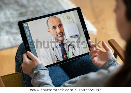 Doktor dizüstü bilgisayar portre konuşma toplantı iki Stok fotoğraf © pablocalvog