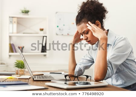 businesswoman suffering from headache stock photo © photography33