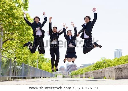 Saltando empresário jovem homem de negócios isolado branco Foto stock © kokimk