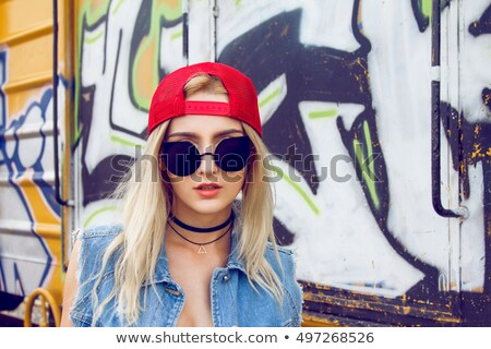 Girl in front of graffiti wall Stock photo © photography33