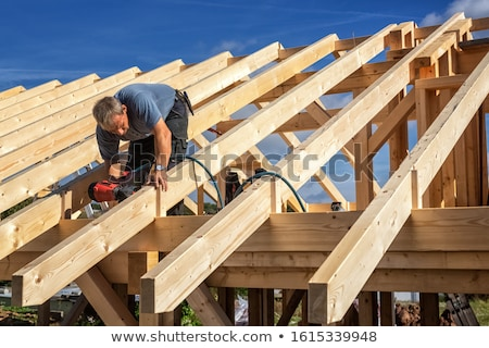 Carpenter with floorboards Stock photo © photography33