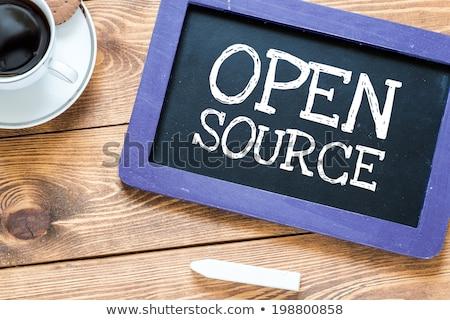 'Open source' handwritten with white chalk on a blackboard Stock photo © nenovbrothers