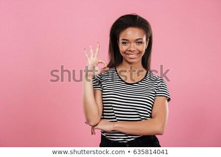 gülen · genç · kadın · tamam · imzalamak · beyaz - stok fotoğraf © stockyimages
