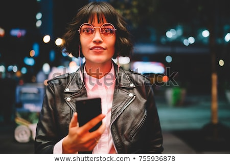 woman portrait at night in city Stock photo © dotshock
