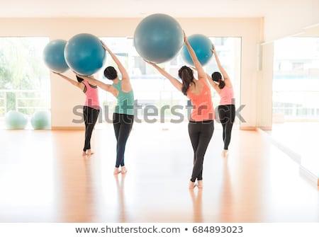 blue toning ball in women pilates class rear view stock photo © lunamarina