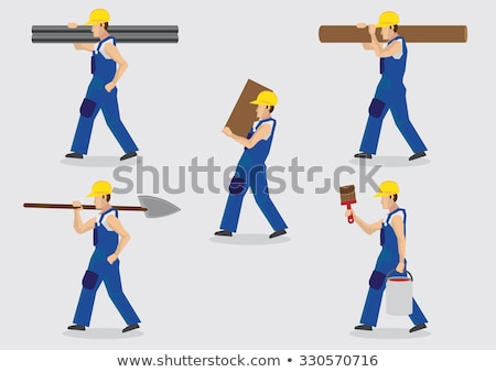 Construction worker carrying tubes Stock photo © photography33