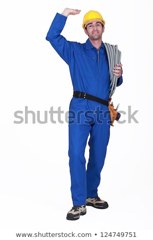 Electrician stood with coil of electrical wiring Stock photo © photography33
