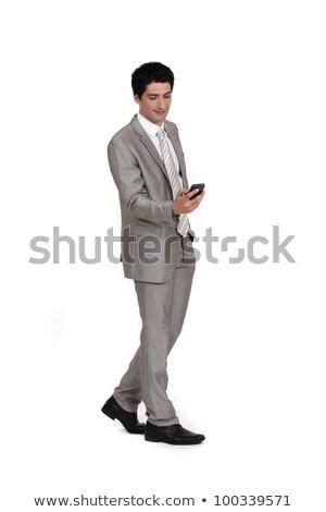 Stock fotó: Fiatal · üzletember · küldés · szöveges · üzenet · sétál · üzlet