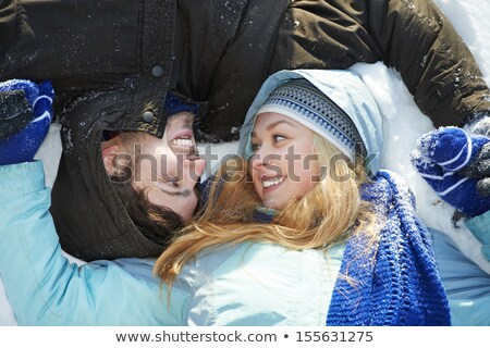 Young couple laying in the snow Stock photo © photography33
