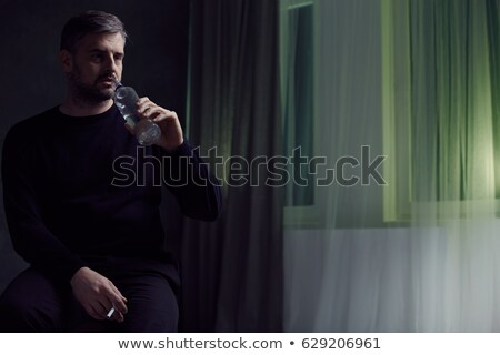 Man drinking vodka from bottle Stock photo © stevanovicigor