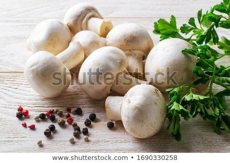 Heap of Raw Champignons  Stock photo © zhekos