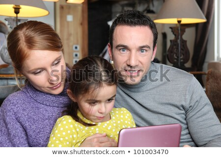 Family gathered on sofa with pink laptop Stock photo © photography33