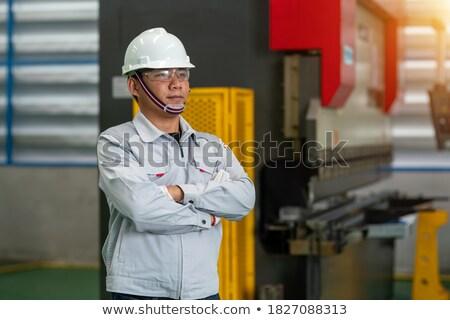 Technikus visel munkavédelmi sisak szemüveg teljes alakos áll Stock fotó © wavebreak_media