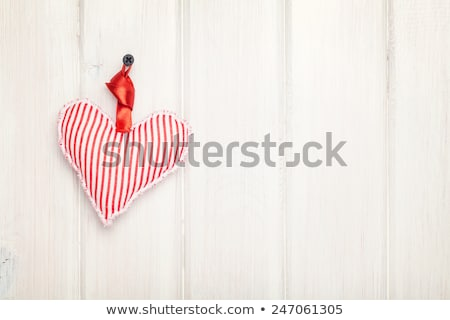 Red textured hearts hanging on white background Stock photo © HASLOO
