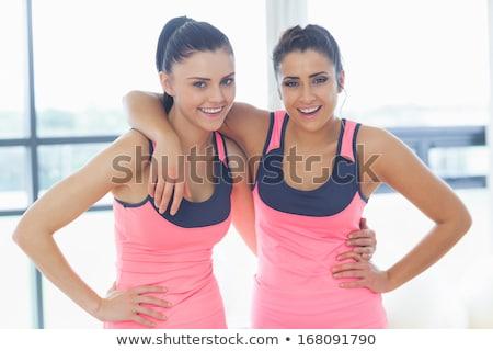 Young shapely woman in pink room Stock photo © konradbak