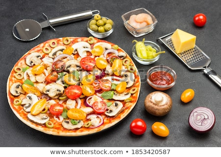 Pizza with mint leaves Stock photo © bdspn