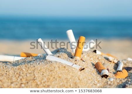 сигарету прикладом конец сжигание синий фон Сток-фото © AndreyPopov