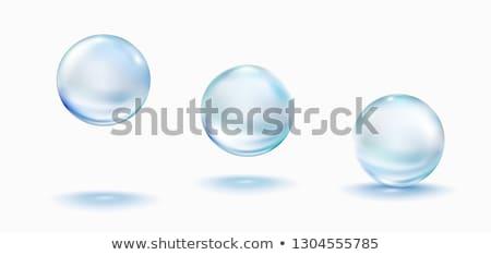 splashed pills on white background stock photo © badmanproduction