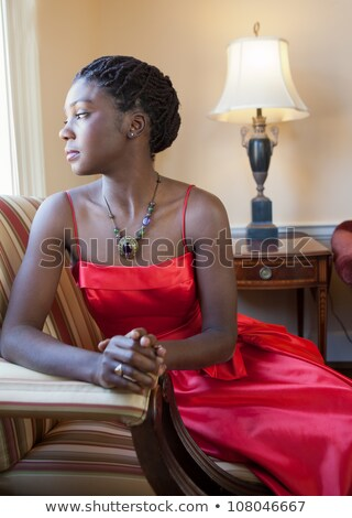 Elegant African American woman in a red gown Stock photo © dash
