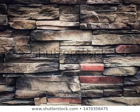 Stone wall made with flat rocks Stock photo © Habman_18