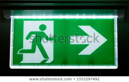 Compliance on Green Direction Arrow Sign. Stock photo © tashatuvango