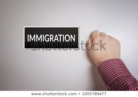 Main immigration bureau porte Homme image Photo stock © stevanovicigor