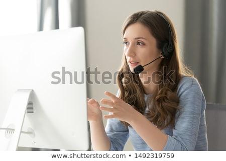 Vrouw hoofdtelefoon hotline online ondersteuning professionele Stockfoto © Kor
