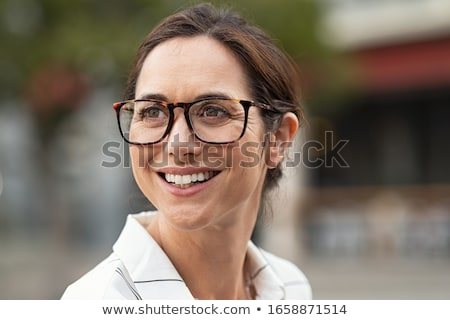 portrait of a beautiful pensive businesswoman looking away stock photo © deandrobot