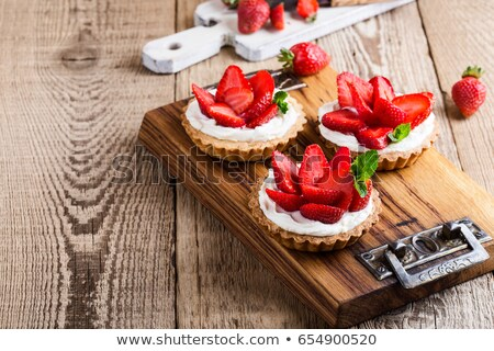 Tart with Fresh Berries on Rustic Wooden Table stock photo © ozgur