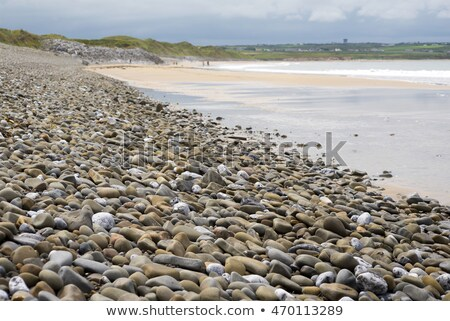 beach and pebbled sand at ballybunion stock photo © morrbyte