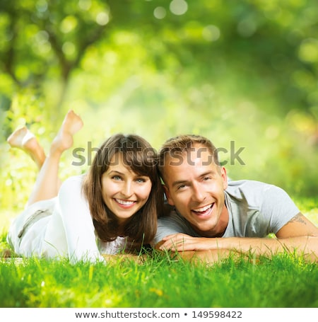 Young couple lying down smiling at autumn background Stock photo © dashapetrenko