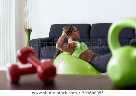 Home Fitness Black Woman Training With Weights On Sofa Stock photo © diego_cervo